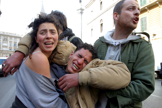 A demonstrator beaten by the police during an anti-war rally is helped by comrades, Rome 2004 - © Giulio Napolitano