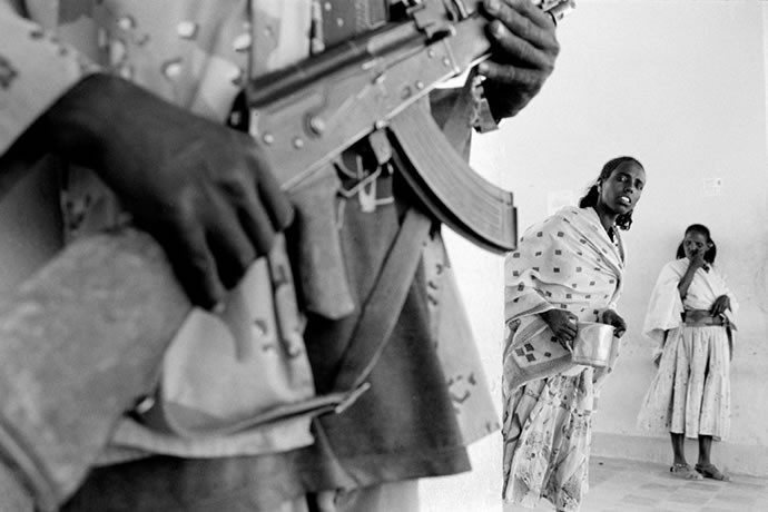 An Eritrean soldier stands inside an hospital in the southern town of Senafè, 2001