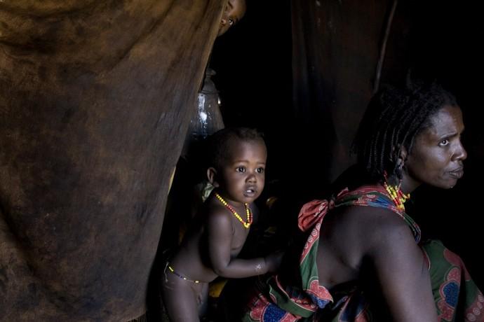 A Gabbra woman in her hut with her children
