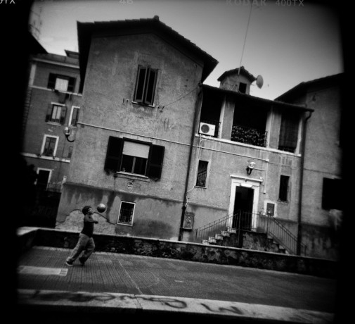 A boy playing football in a courtyard in Garbatella neighbourhood - © Giulio Napolitano