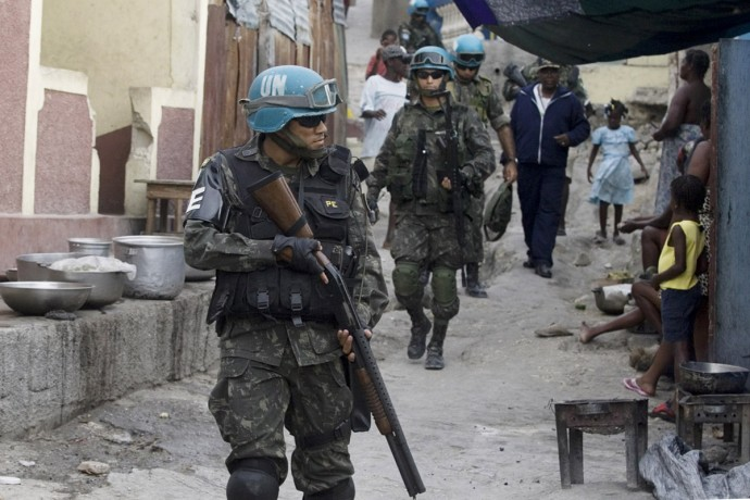 Members of the United Nations Stabilization Mission in Haiti patrolling Citè Soleil, Port-au-Prince  - © Giulio Napolitano