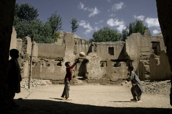 Children playing in a bombed courtyard, Bamyan