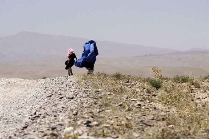 A woman wrappend in her burka on the way from Karukh to Herat  - © Giulio Napolitano
