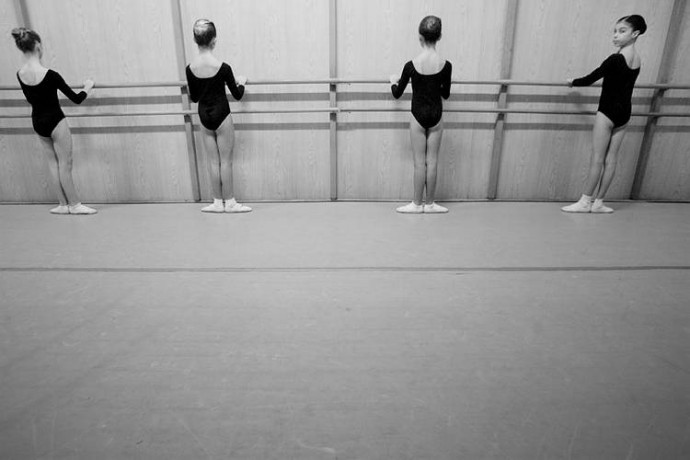 Young dancers performing exercises at the Opera House ballet school  - © Giulio Napolitano