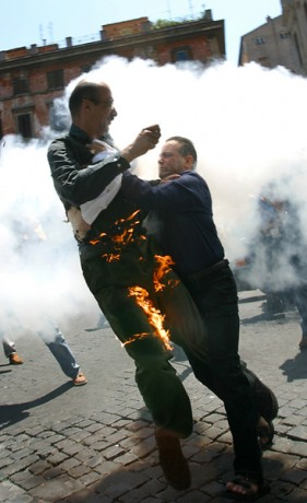 An iranian man burn himself in sign of protest in front of the French Embassy in Rome, 2003  - © Giulio Napolitano