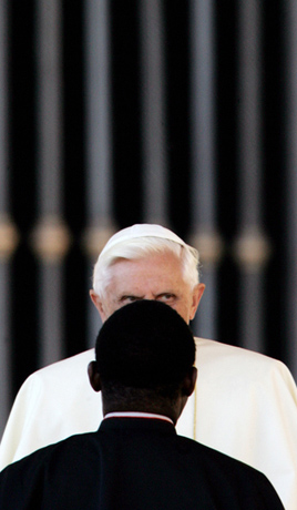 Pope Benedict XVI talks with a bishop during his weekly general audience, Rome 2006 - © Giulio Napolitano