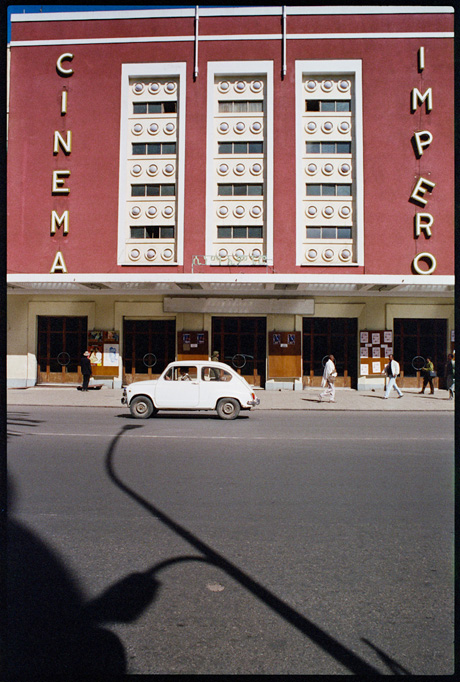 An old Fiat 600 passing by the Cinema Impero, Asmara - © Giulio Napolitano